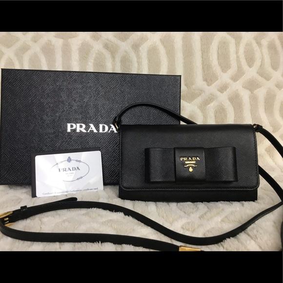 91e761209d Prada wallet on chain in black saffiano leather.  M 5c2f1cf4baebf6c67b9a5ebb. Other Bags ...